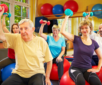 group of elderly having physical therapy